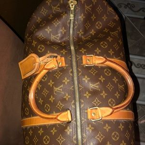 Authentic Louis Vuitton keepall 55 w tag